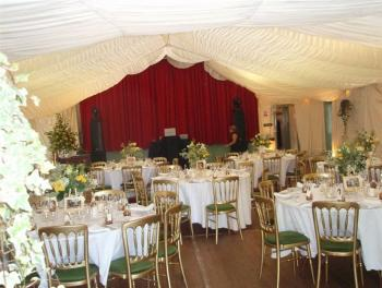 Wedding, using a marquee lining and hired-in chairs and tables.