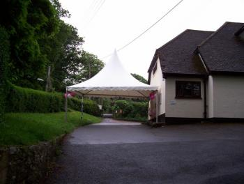 Wedding, showing the use of a hired gazebo to create a lobby for arriving guests.